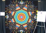 this was a cool quilt....great use of the flowered fabric