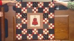 One of the many doll quilts Joanne has made for her little ones