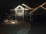 The Bongean house lit up at night...our angels have a garland and bulb that spell out Peace on Earth...