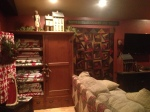 Wardrobe with antique quilts and crazy quilt from A Primitive Christmas...
