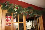Garland in the Kitchen leading to the Sun room...I actually leave this up all year, but take off the mittens.