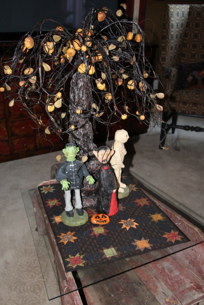 A little quilt...From Lori Smith...with a dark primitive gatherings touch...along with some spooky guys...