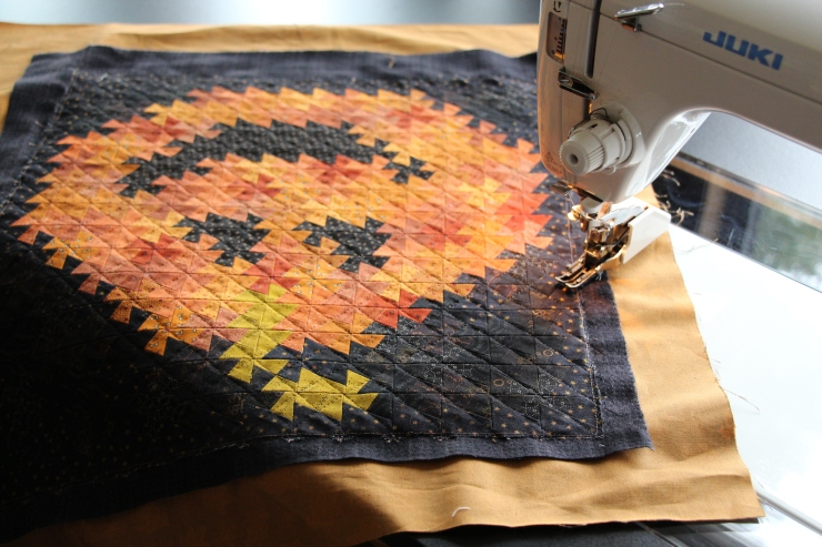 Itty bitty Twister Jack being machine quilted...