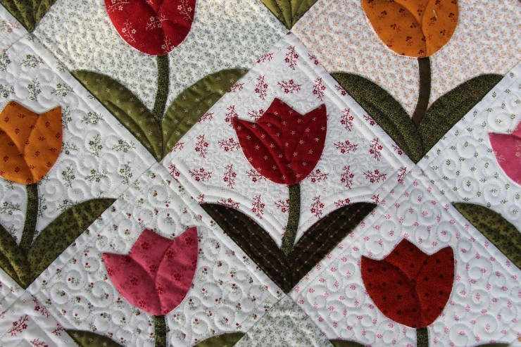 Theresa's tulips...quilting by Linda Hrcka...notice the 1 renegade quilted block?