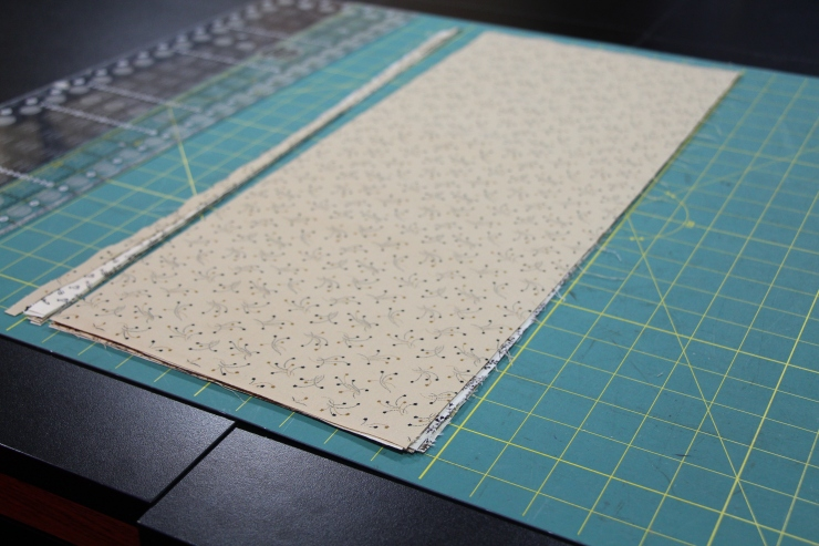 Layer fabrics and trim off the left edge.