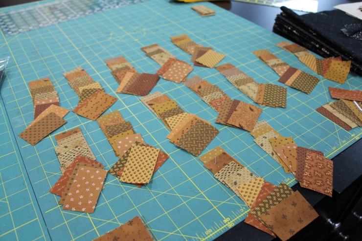 Make 20 piles and start sorting out how many pieces you will need for each block....while mixing up the prints