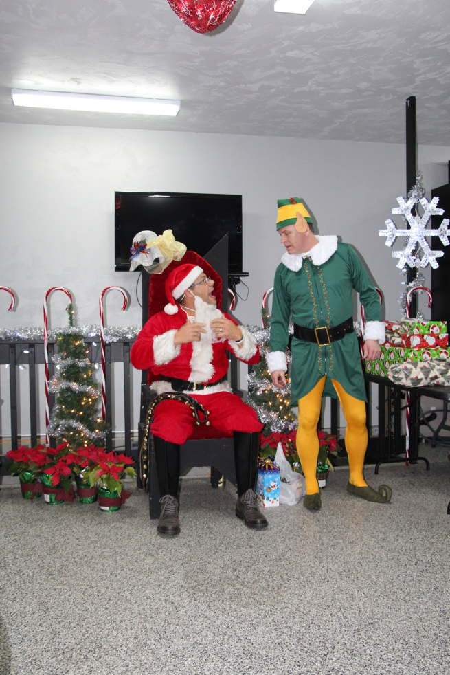 Santa and Elf at work…Elf got some new duds from last year...
